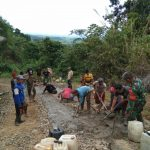 Perbaiki Jalan Dan pembuatan J.U.T. lewat gotong royong Babinsa Koramil  1002-07/ pagat tujuannya Atasi kesulitan Rakyat